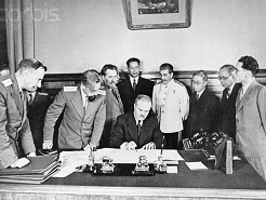 16 Jan 1946 --- Signing of treaty of friendship and alliance between Soviet Union and Chinese Rep. looking on as V.M. Molotov signs the treaty are J.V. Stalin, S.A. Lozovsky, Dr. T.V. Soong, Mr. Wang Shi-Tse, Mr. Foo Ping-Sheung, A.A. Petrov, USSR Ambassador to China and others. --- Image by © Bettmann/CORBIS
